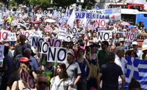 "People hold placards reading ""No"" during a demonstration in support of Greece, in Madrid on July 5, 2015. (Agence France-Presse)"
