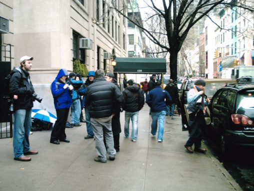 Photographers waiting outside the entrance to the apartment block where Bernard Madoff was under house arrest. Red Carlisle via flickr