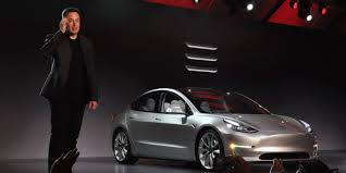 First Model 3 Electric Cars Handed Over To Early Buyers By Tesla's Musk