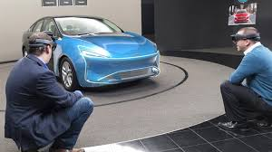 Designing Of Cars Being Done With Hologram Goggles At Ford