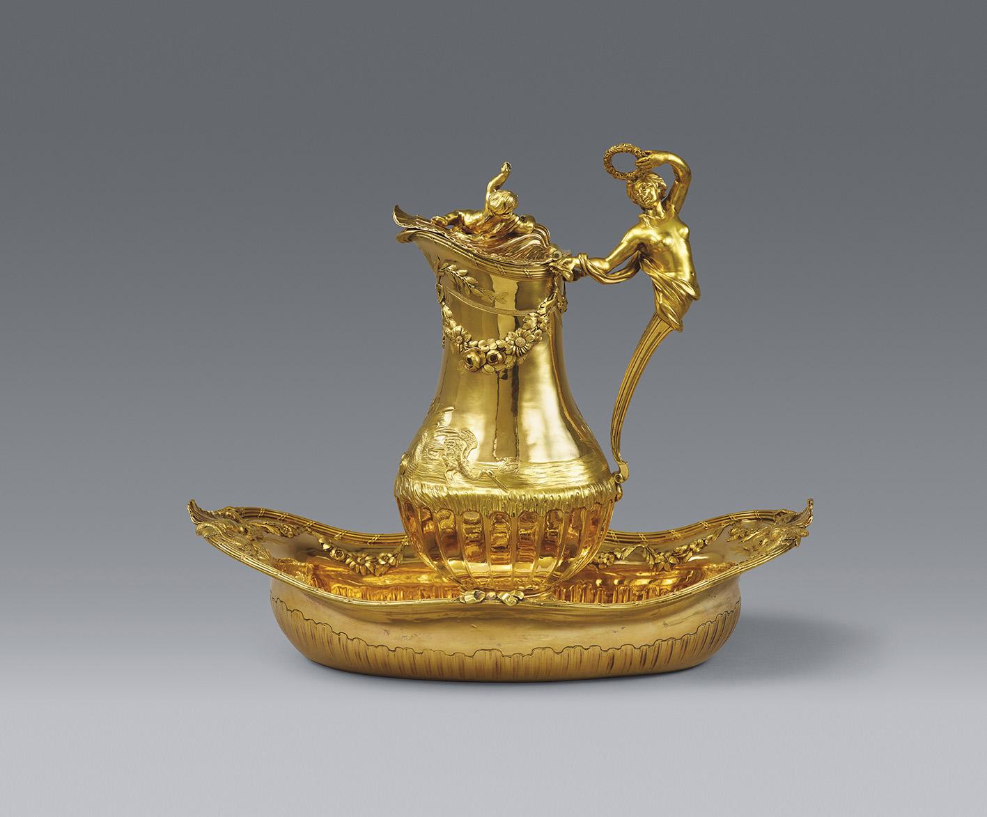 Jean-Baptiste François Chéret, Paris, 1770. Toiletry set for the Marquis and Marquise de Montmelas, silver with two-toned gold plating, h. of pitcher 29.5 cm/11.6 in, h. of basin 9 cm/3.5 in, l. 36.3 cm/14.3 in, d. 23.5 cm/9.3 in. Total weight 2,479 g/87.44 oz. Estimate: €1/1.2 M