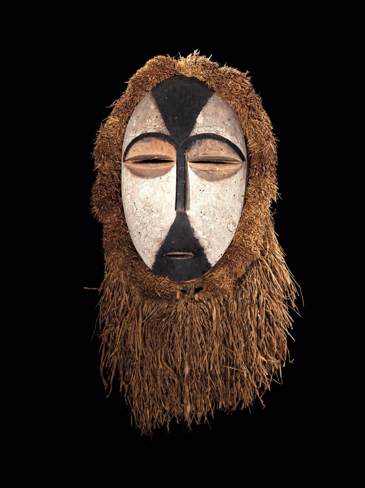 Gabon, 19th century, Galoa People, Okukwe Mask, wood, black and white pigments, raffia, h. 27 cm/10.62 in. Galerie Patrik Fröhlich. Courtesy Galerie Patrik Fröhlich